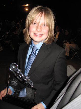 Greyson with tagie award sitting down