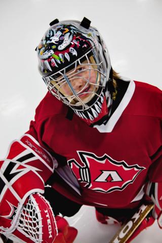 Greyson in hockey helmut with BricStix