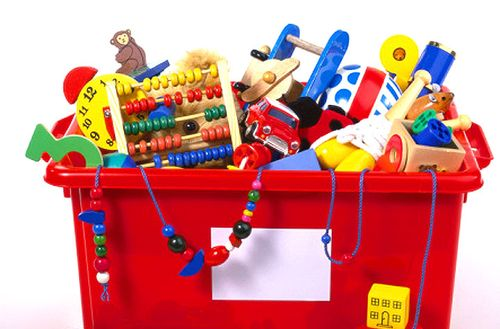 Red-toy-box-overflowing-with-toys-dave-king-getty