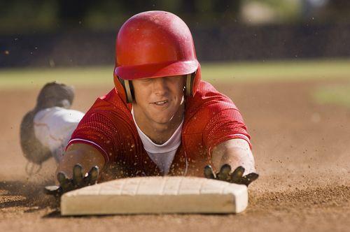 Bigstock-Young-baseball-player-sliding-36386830
