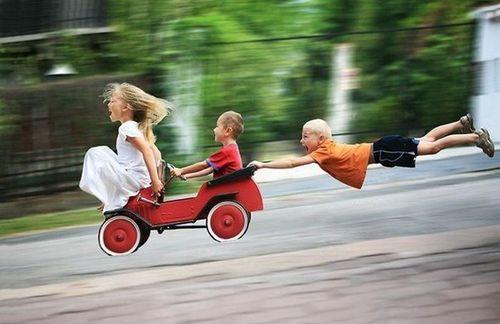 Children-down-hill-having-fun