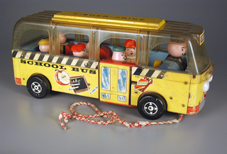 The Fisher-Price Safety School Bus featured the first removable Little People. This version of the pull toy dates from about 1961. The Strong, Rochester, New York.