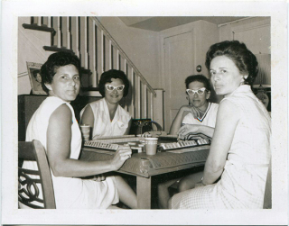 Photograph of women playing Mahjong  1957  gift of Lauren Lean. The Strong  Rochester  New York.