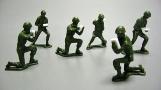 Little green army figures, softened in the hot sun and modified to included cell phones and electronic tablets. Gift of Major William Hartel. Courtesy of The Strong, Rochester, New York.