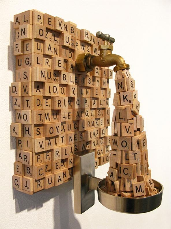 Faucet-sculpture-spews-out-scrabble-tiles.w654