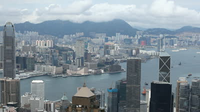 Stock-footage-aerial-view-of-hong-kong-island-skyline-victoria-harbour-kowloon-peninsula-time-lapse