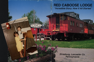 Julia and Bobby Novakovic at the Red Caboose Motel  1993  with Red Caboose Lodge souvenir booklet  n.d. Courtesy of Bill Novakovic.