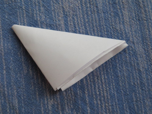 Folded-paper-triangle-blue-background