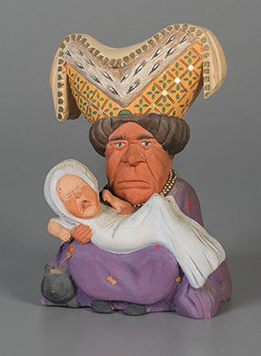 Duchess figure with crying baby  1948  gift of Glen Cubitt. The Strong  Rochester  New York.